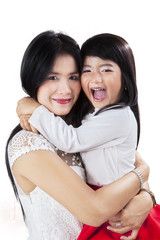Portrait of cheerful mother and daughter