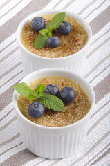 creme brulee with blueberries and mint
