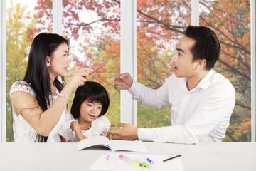 Sad girl with parents quarreling