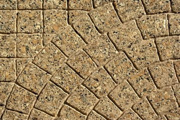 Paving stones that are laid in a nice pattern.