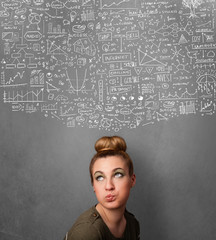 Young woman gesturing with sketched charts above her head