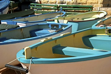 Rowing boats in harbor for hire on Malta.