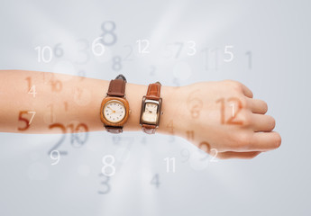 Hand with watch and numbers on the side comming out