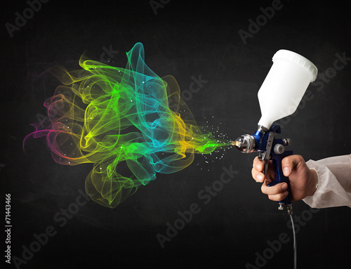 canvas print picture Painter working with airbrush and paints colorful paint