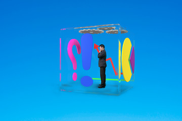 man thinking in glass cubic