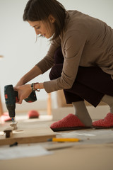Woman Putting Together Self Assembly Furniture