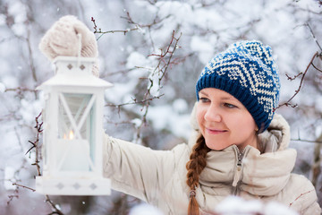Young woman with Christmas lantern