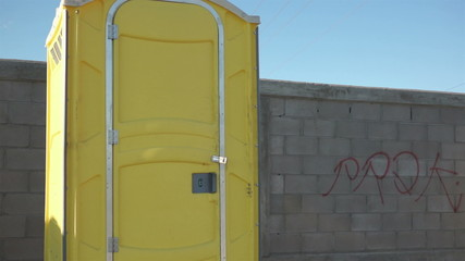 Male Construction Worker Portable Bathroom Close