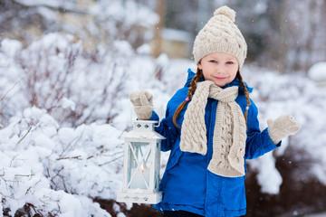 Little girl with Christmas lantern