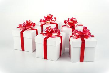 white gift boxes on gray