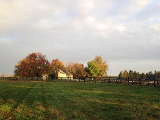 fall sunrise with barn
