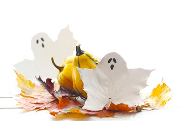 ghosts and pumpkins on a wooden background