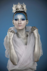 Portrait of a woman with creative make up as Ice Queen