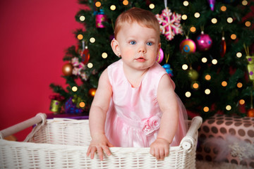 Cute baby girl under the Christmas tree