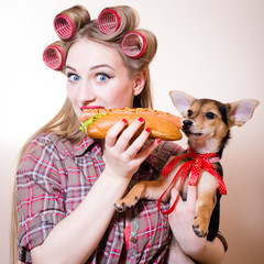 hungry girl & puppy sharing hotdog