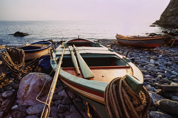 Italy, Calabria, wooden fishing boats ashore