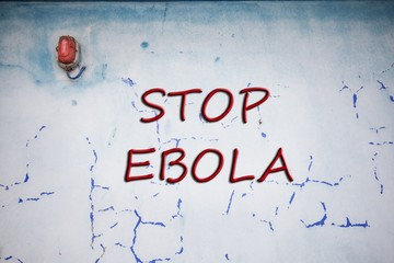 Words Stop Ebola over grunge background wall