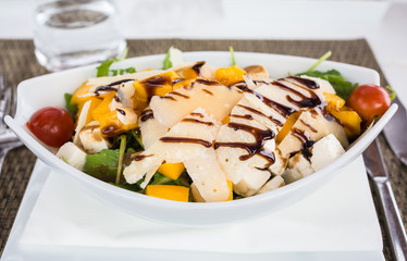Mango, goats cheese, salad.