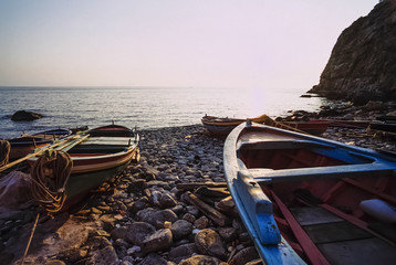 Italy, Calabria, wooden fishing boats ashore