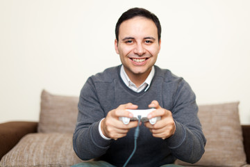 Man playing videogames on his sofa