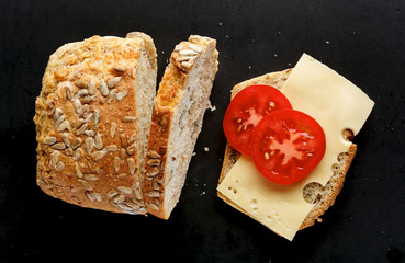 Sandwich with homemade bread with cheese  on a black background