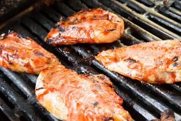 barbeque chicken cooking on the grill