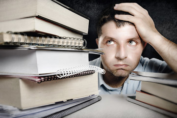 Young Man Overwhelmed and frustrated in education stress concept