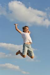 Boy on blue sky background