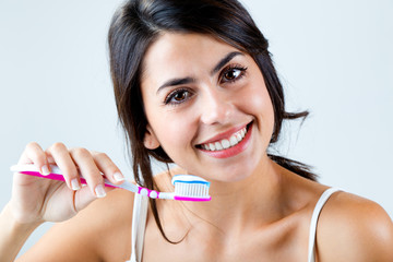 Beautiful young woman picking his teeth.