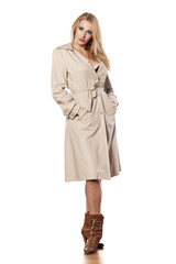 pretty girl in a coat posing on white background