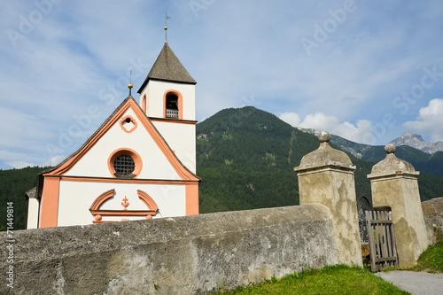 canvas print picture Alte Dorfkirche mit Mauer