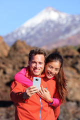 Selfie couple hiking in beautiful nature