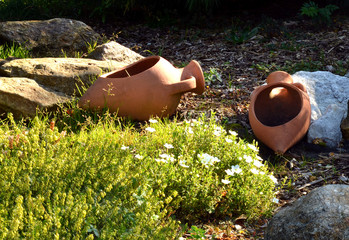 Garden with flowerpot-shaped vases