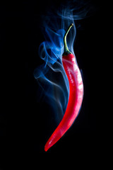 Smoking Hot Red Chilli Pepper isolated on a black background