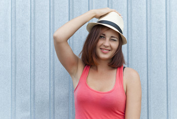Portrait of beautiful girl in hat outdoors.