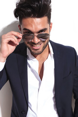 Handsome business man taking of his sunglasses