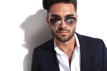 Close up image of a handsome business man wearing sunglasses