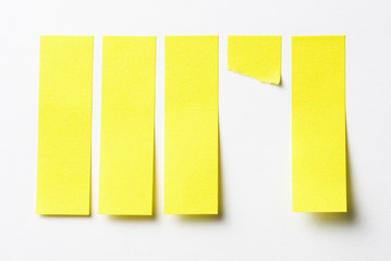 Safe sticky notes and torn out one on light background