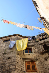 Old house in Trogir (Croatia) with laundry drying outside