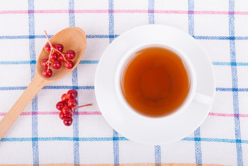 Tea with viburnum berries.