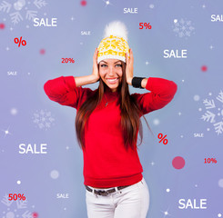 pretty woman smiles in a white hat with patterns in red sweater