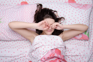 The girl woke up rubbing his eyes