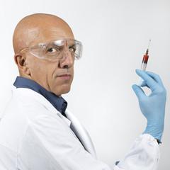 DOCTOR USING SYRINGE