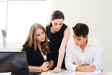 young people business team working together in a meeting room