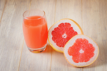 Glass of grapefruit juice and fresh citrus slices