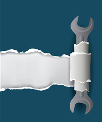Torn paper background with spanner