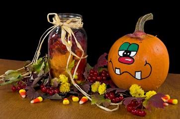 fall candle in mason jar with fun pumpkin