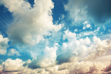 Bright blue cloudy sky, vintage toned photo background