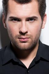 Portrait of handsome man in black shirt.