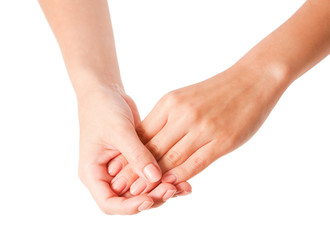 Female hands applying body lotion on white background.